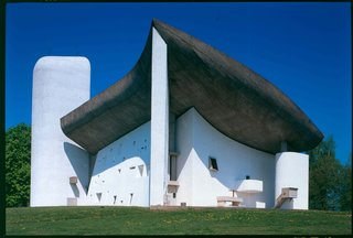 UNESCO Adds 17 Le Corbusier Buildings to Its Storied Ranks - Photo 1 of 8 - The sculptural Notre-Dame du Haut is unlike any other of the buildings by the architect. Built to replace a church after World War II, the modern chapel was designed to be a somber space that relies on the expressive form of the structure and use of nature light to create moments of reflection for visitors.