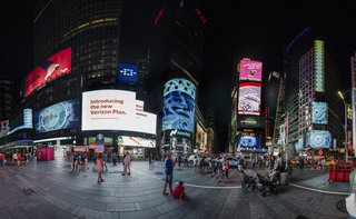 Times Squares Transforms Into a Surreal Fish Tank at Night - Photo 4 of 6 - The contrast between Stanton's visual vocabulary and Times Square helps create the effect of viewing another world through a window. The Nasdaq screen stands out in particular since it wraps around the whole building.