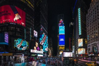 Times Squares Transforms Into a Surreal Fish Tank at Night - Photo 3 of 6 - A porthole view of the ocean appears before tentacles wrap around it and lead the viewer to the bottom of the sea.