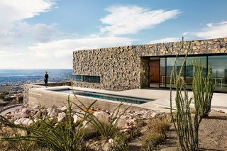 Views Stretch to Mexico at This Hard-Edged Texas Home - Photo 1 of 3 - Lodged in a hillside along the arid U.S.-Mexico border, an earthy family home absorbs grand vistas of El Paso, Texas, as well as Juárez, Mexico. A lap pool extends toward a canyon.