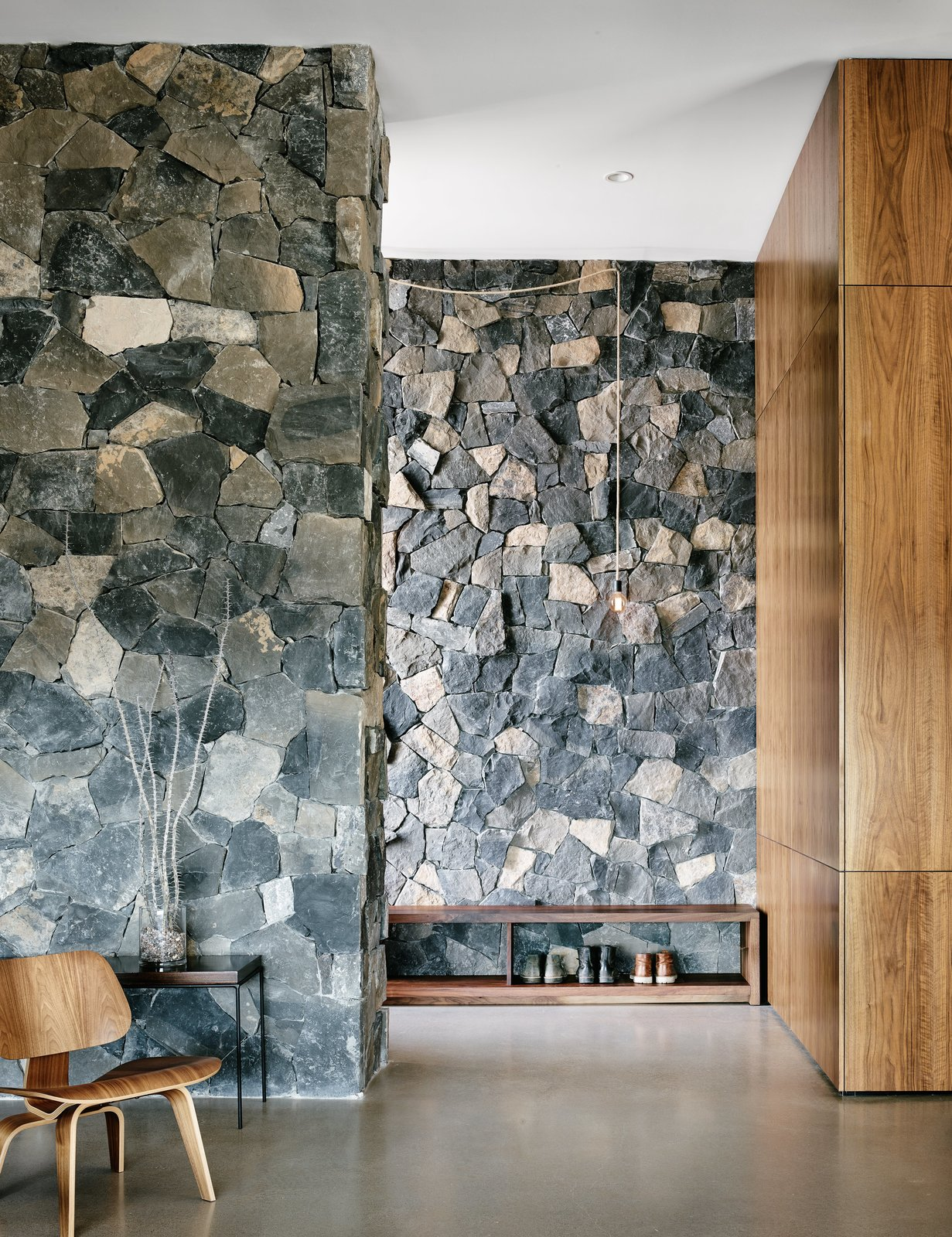 The two basalt layers, meanwhile, showcase American black maple and polished concrete floors. Tagged: Hallway and Concrete Floor.  Photo 4 of 4 in Views Stretch to Mexico at This Hard-Edged Texas Home