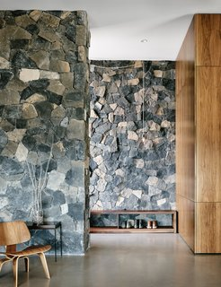 Views Stretch to Mexico at This Hard-Edged Texas Home - Photo 3 of 3 - The two basalt layers, meanwhile, showcase American black maple and polished concrete floors.