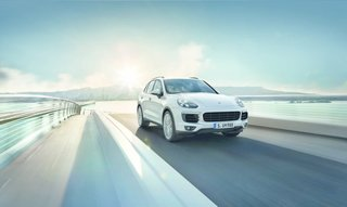 """New Porsche Cayenne Editions Promise Greater Efficiency Without Compromising Performance - Photo 3 of 7 - In front, the hood is likewise broadened. The """"airblades"""" on the left and ride side are more than sleek design flourishes. Together, they efficiently channel air to the car's intercooler."""