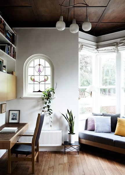 "The original coffered wood ceiling of Kate Tucker and Tom Crago's home in Melbourne, Australia, provides a dramatic backdrop for a vintage pendant from Angelucci 20th Century. ""The bay windows and high ceilings were so lovely, we really wanted to do as little as possible up front,"" Kate says of the plan for the house."