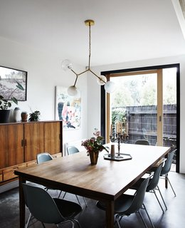 An Unassuming Edwardian Saves the Best for Out Back - Photo 5 of 12 - A Y chandelier by Douglas and Bec hangs above a vintage table and chairs.