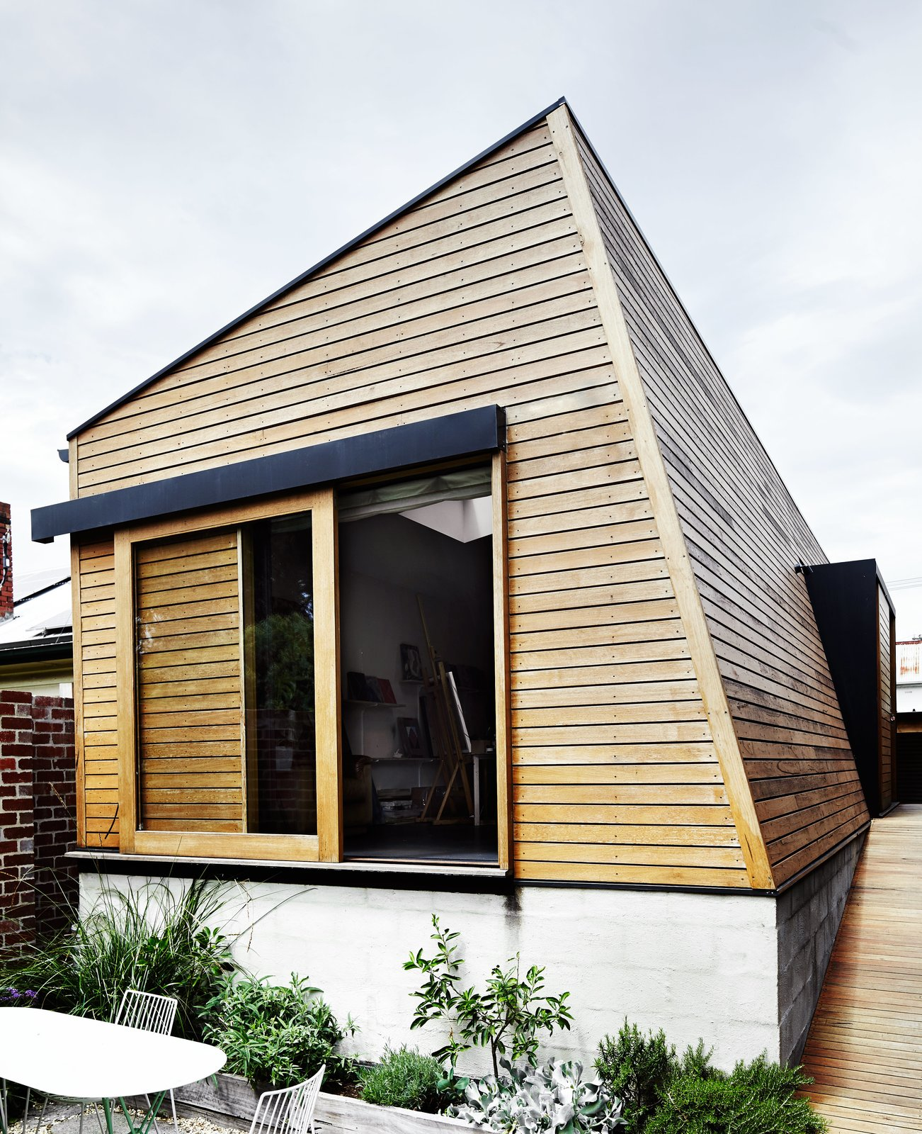 An angular new outbuilding fills the footprint of what was once an inground swimming pool, completing an awkward corner at the back of the site.  Photo 11 of 13 in An Unassuming Edwardian Saves the Best for Out Back