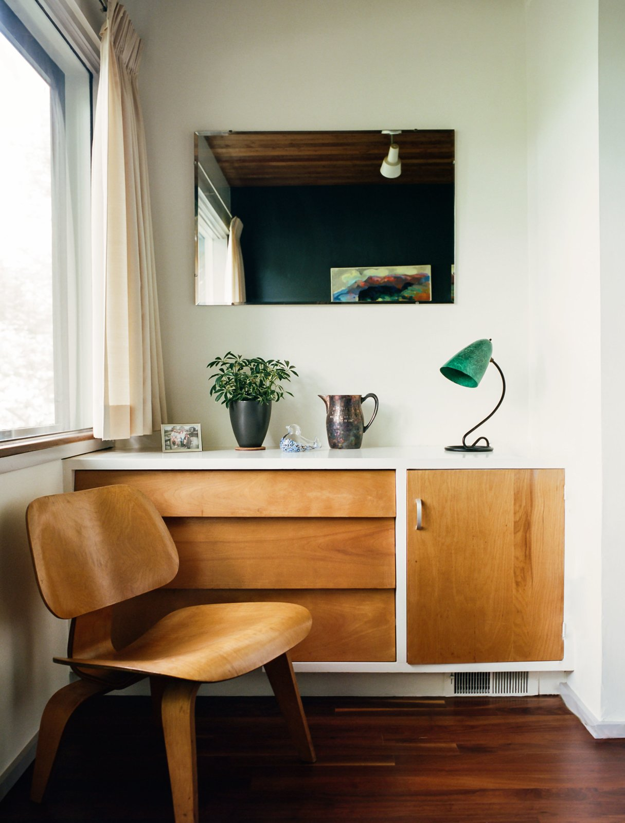 Built-in details include a dresser that pairs with an Eames molded plywood lounge chair in a guest bedroom.  Photo 6 of 16 in Kansas City Royal