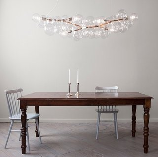"""Long bubble chandelier by Pelle Designs is a line of delicate and airy compositions of luminous glass globe clusters (2008)."""