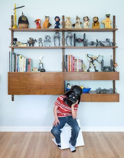 American Beauty - Photo 5 of 8 - Lawrence, seven, shows off his toy collection on a vintage Cado wall unit in his bedroom.