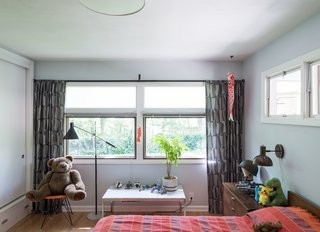American Beauty - Photo 6 of 8 - The walls are painted in Borrowed Light by Farrow and Ball. His bed is a George Nelson design for Herman Miller.