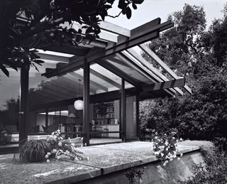 Creative Revival of a Modernist Gem - Photo 11 of 14 - The architects maintained the midcentury post-and-beam construction and Japanese-inspired details of the original building, while brightening and expanding the interior living spaces.