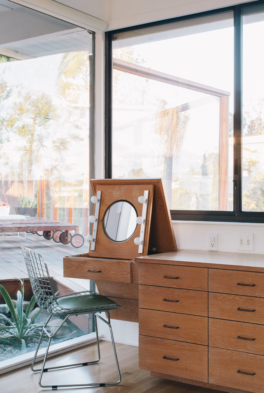"Situated in a built-in cabinet, a folding vanity in the master bedroom remains as it was when the home was built. ""We knew that with some work, the house could be brought back to a clean and simple classic modern home,"" Tyler says.  Midcentury Homes by Dwell from Pretty as a Picture"