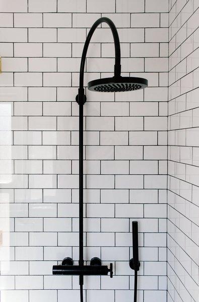 Savoy Graphite floor tiles by Ann Sacks complete the shower.