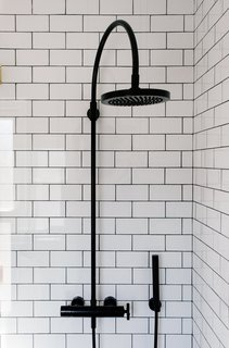 A 1925 Portland Home Is a Rad Mashup of 20th-Century Styles - Photo 7 of 9 - Savoy Graphite floor tiles by Ann Sacks complete the shower.