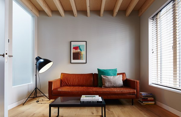 The Bank Slimm sofa by local furniture purveyor Loods 5 is paired with pieces sourced from British retailers Made and Habitat in the second-floor living room.