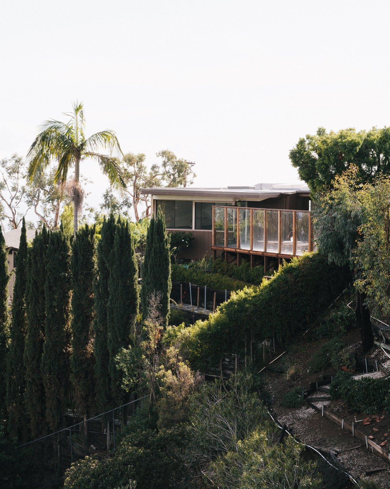 Tagged: Exterior, Glass Siding Material, Wood Siding Material, Metal Siding Material, and House.  Midcentury Homes by Dwell from Pretty as a Picture