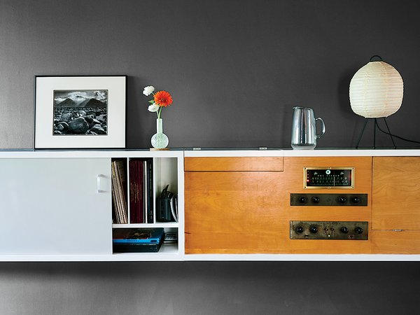 The built-in storage system includes a Fisher stereo that still works.