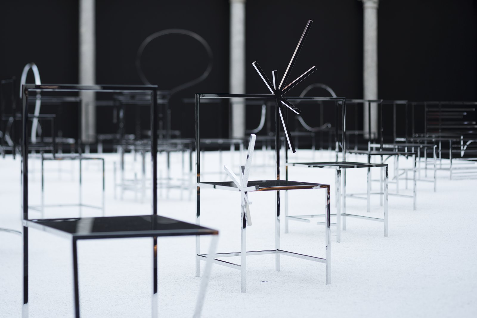 The chairs are completed with a mirrored finish.