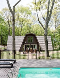 "One Couple's Imagination Goes Wild at a 1967 Weekend Retreat - Photo 1 of 12 - In search of relaxation, Cain Semrad and Damen Seminero happened instead upon a home improvement challenge: a pine-covered ""rhombus-frame"" house built in 1967."