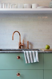 Modern Becomes Eclectic in This Renovated Brooklyn Townhouse - Photo 6 of 13 - Lyons and Brill designed several custom touches, like the copper-plated knobs they installed on the Sektion kitchen cabinetry from IKEA, painted in Farrow & Ball's muted Breakfast Room Green.