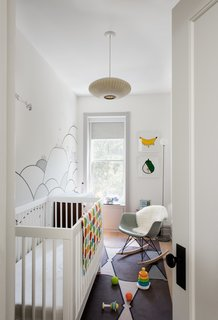 15 Modern and Creative Spaces For Kids - Photo 4 of 15 - A mural by local illustrator Kale Williams—a good friend and the wife of one of Brill's partners—provides the backdrop forthe nursery.