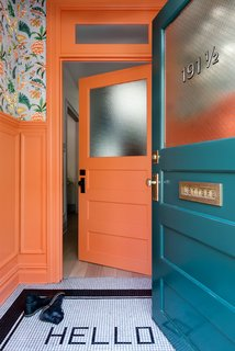 "12 ""Pro-Tips"" For Installing Wallpaper in Your Home - Photo 1 of 13 - The vestibule is painted in Benjamin Moore's coral-hued Hot Spice and covered in a Cuban-inspired floral wallpaper by fashion designer Matthew Williamson for Osborne & Little."