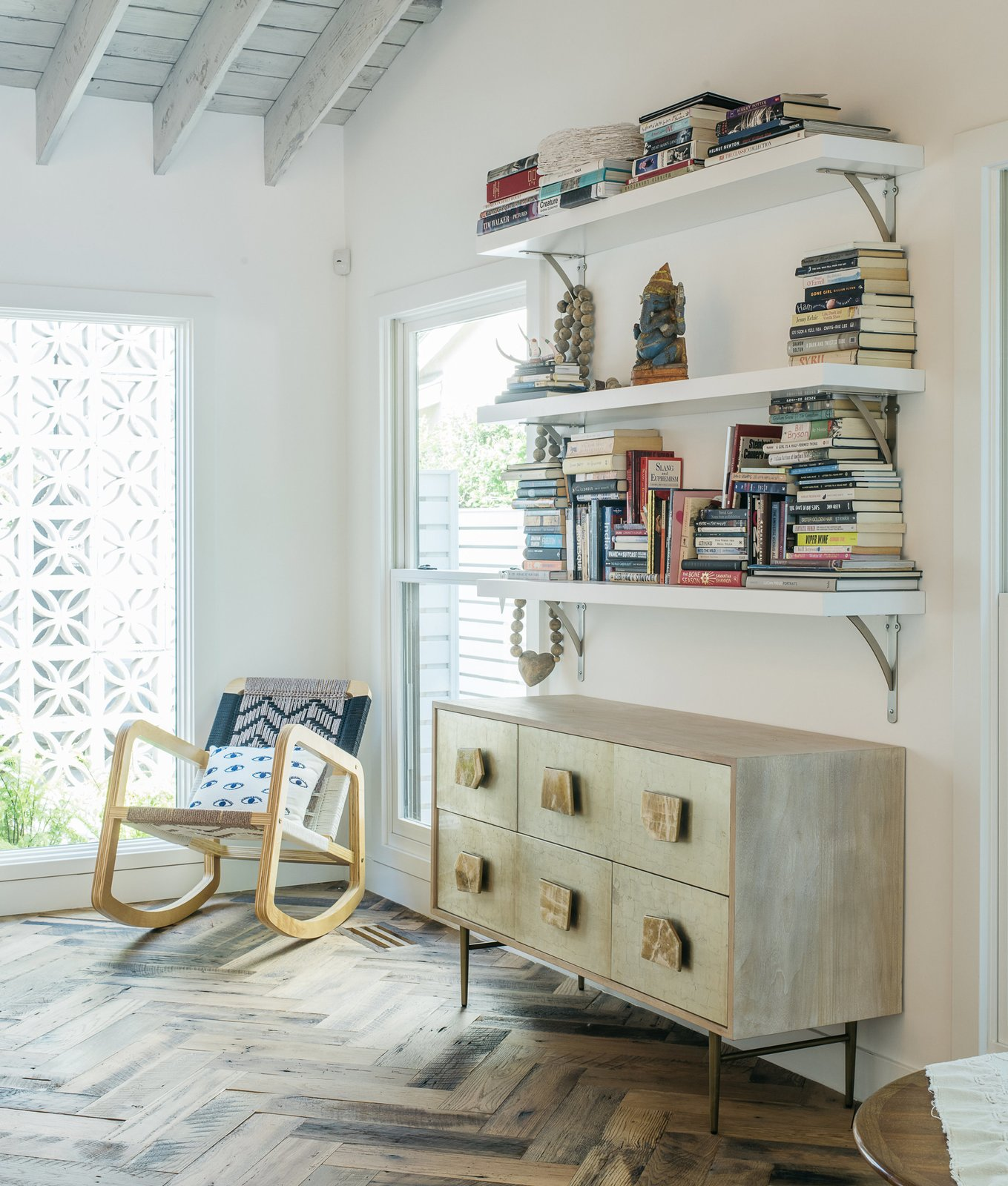 Broden gave the formerly low-ceilinged living room a high pitch and added more windows for light. For the floors, Lena chose salvaged oak hand-laid in a herringbone pattern. The Roar + Rabbit dresser is from West Elm.
