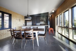 House of the Week: Whale Watching at This Edgy Abode - Photo 1 of 2 - Materials throughout the house are elemental, befitting its wilderness setting. The walls are made of cross-laminated timber and the floors are slabs of heated concrete.
