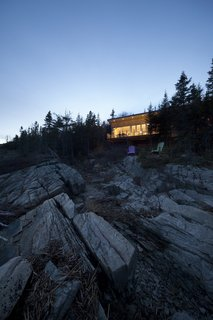 House of the Week: Whale Watching at This Edgy Abode - Photo 2 of 2 - Visitors can keep lookout for the St. Lawrence River's resident marine mammals, which include Beluga and Sperm whales, from a pair of Adirondack chairs.