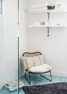 Dandelion cement tiles from Marrakech Design adorn the master bathroom. The chair is from Lawson Fenning.