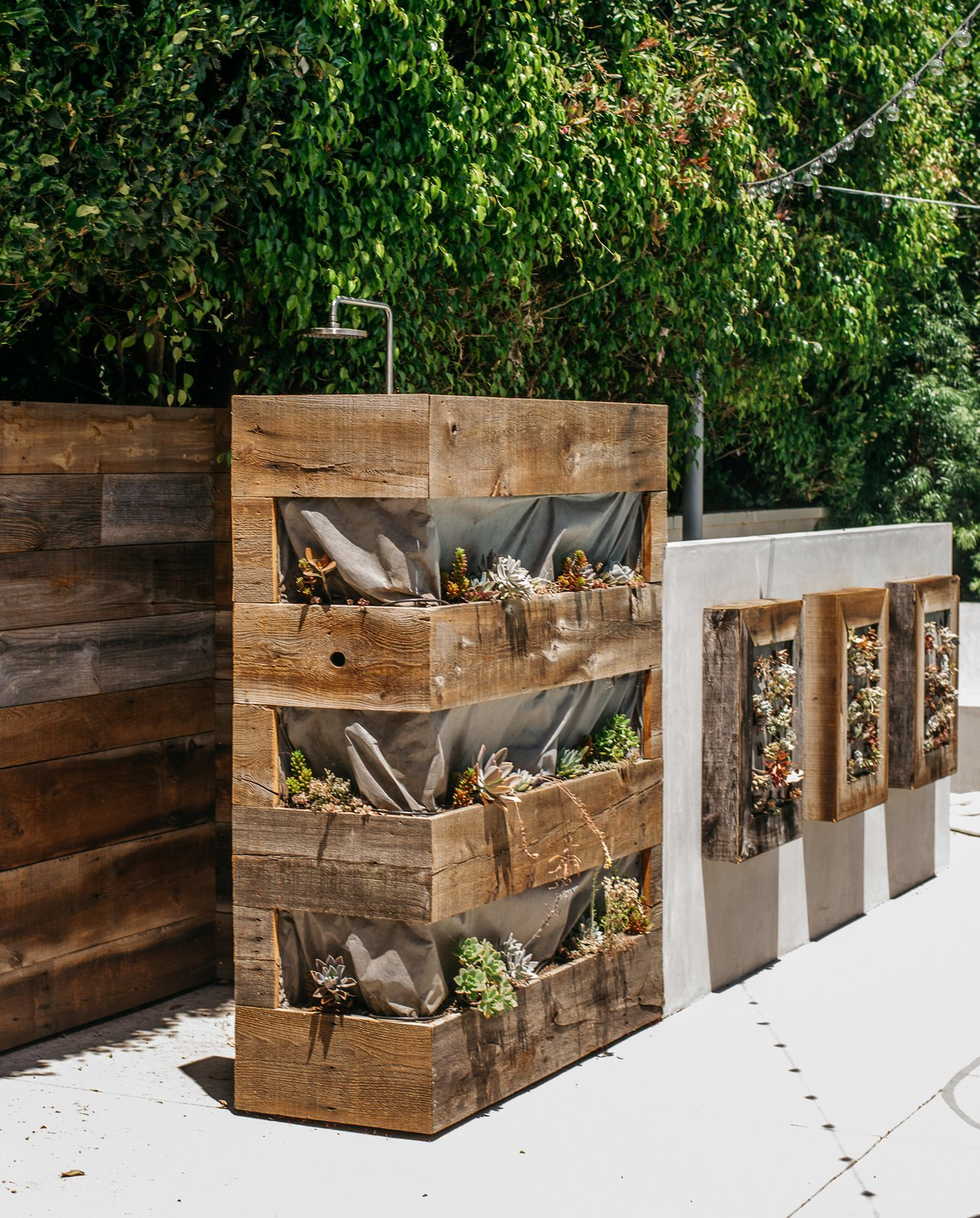 The outdoor shower, which he designed in collaboration with landscape contractors Warren-Avard, is surrounded by reclaimed hemlock planters. Tagged: Outdoor, Raised Planters, and Back Yard.  Photo 10 of 15 in Lena Headey's Off-Camera Castle