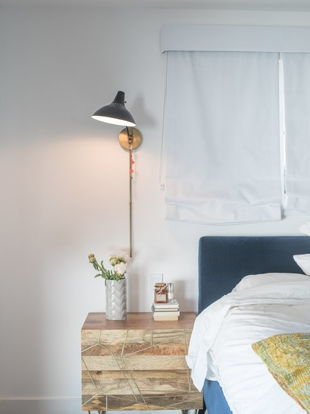 """A downstairs guest bedroom is a welcome retreat for visitors. """"Because I do so much traveling, if someone comes to stay, I want them to feel they can just be,"""" says Lena. The Roar + Rabbit brass-inlaid nightstand is from West Elm.  Photo 11 of 15 in Lena Headey's Off-Camera Castle"""