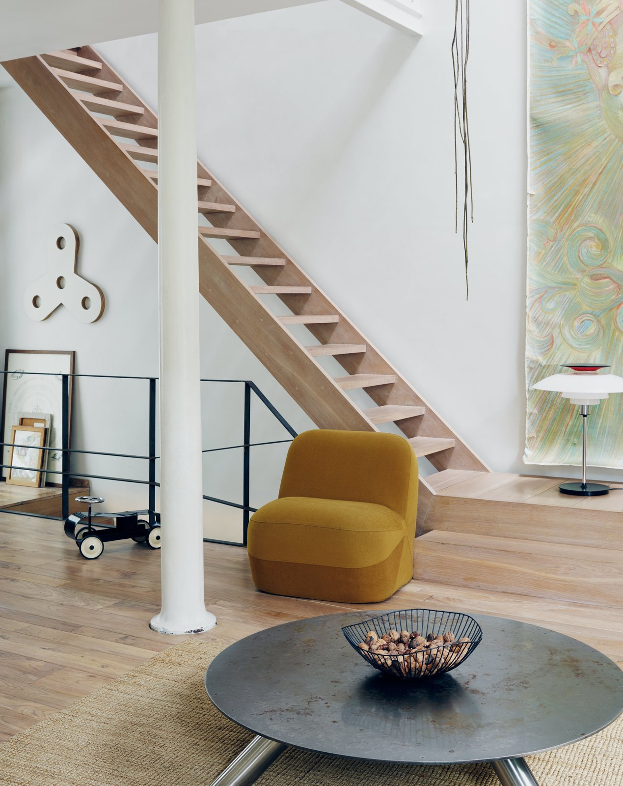 Venlet's prototype of the armless Emperor's Hat Chair sits near his Cuppa coffee table, made of Cor-Ten and stainless steel. Tagged: Staircase and Wood Tread.  Photo 4 of 11 in Futuristic Forms Meet Historical Details in Designer Danny Venlet's Brussels Home