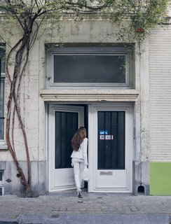 Futuristic Forms Meet Historical Details in Designer Danny Venlet's Brussels Home - Photo 6 of 11 - Venlet's wife and business partner, Evi Lippens, enters the home's unassuming street entrance in the city's Flemish Dansaert district.
