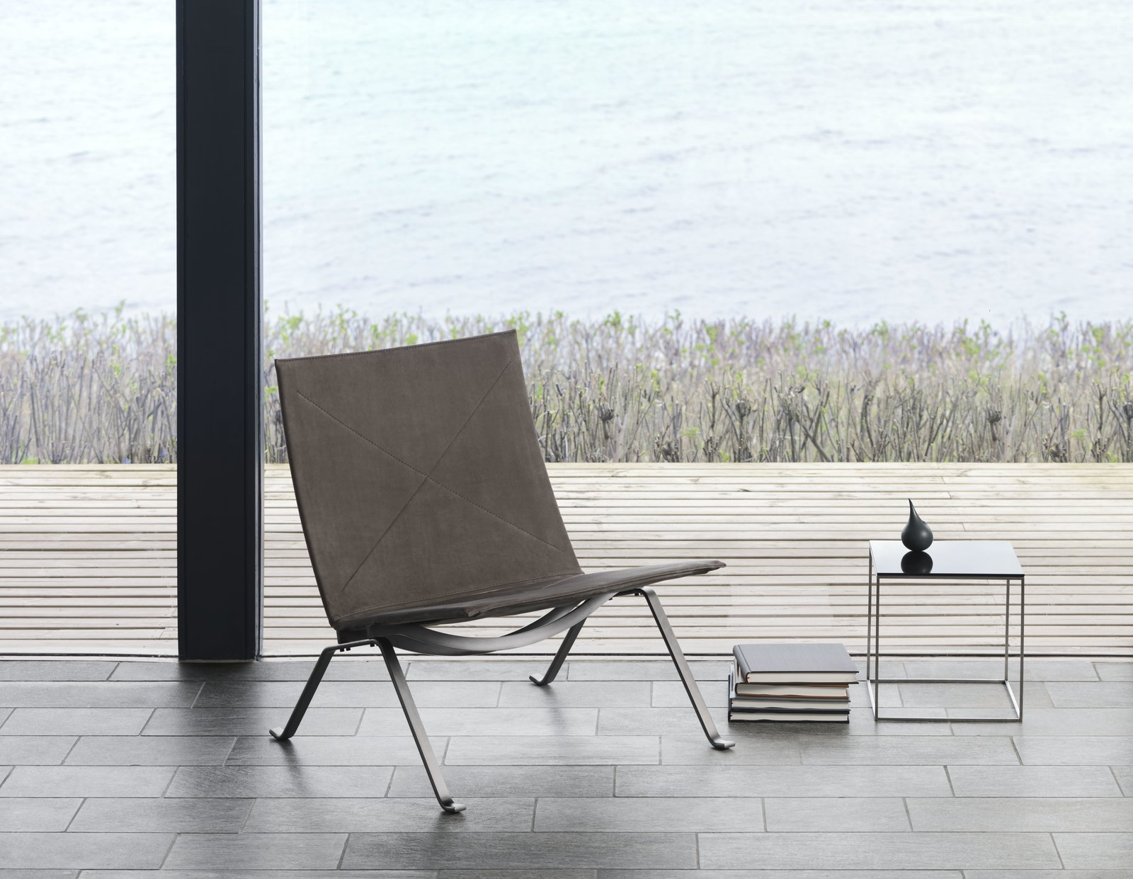 As an evolution from the PK25, the PK22 is less sculptural and more refined. The chair made its first appearance in 1956. Instead of being made from one piece of steel, the construction allows the chair to be broken down, which makes it easier to ship. In making sure that every aspect of the design counted, even the screws have aesthetic appeal. For the anniversary, the steel frame is darkened and finished in a nubuck leather.  Photo 6 of 11 in 10 Things You Didn't Know About Poul Kjærholm