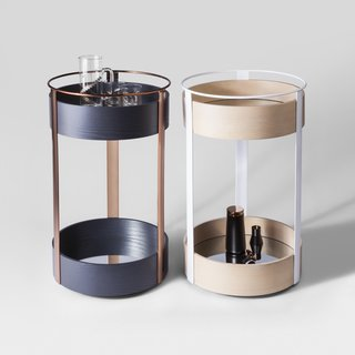 """Bar Trolley, $149.99. Deam + Dine designed each piece to be versatile and """"aesthetically durable,"""" like this circular, two-tier bar cart made from mirrored, wooden trays and a powder-coated steel frame."""