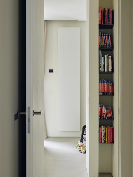 """The designers sought to create an abundance of storage options—including narrow niches in the hallway, used to hold travel guides. As Di Stefano puts it: """"When a client says, 'I've filled allmy wardrobes and still have space left over,' that means the mission is accomplished."""""""