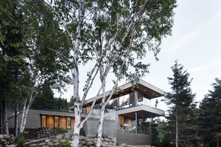 10 Gravity-Defying Cantilevered Homes - Photo 9 of 23 - The south-facing facade looks out towards the forest.
