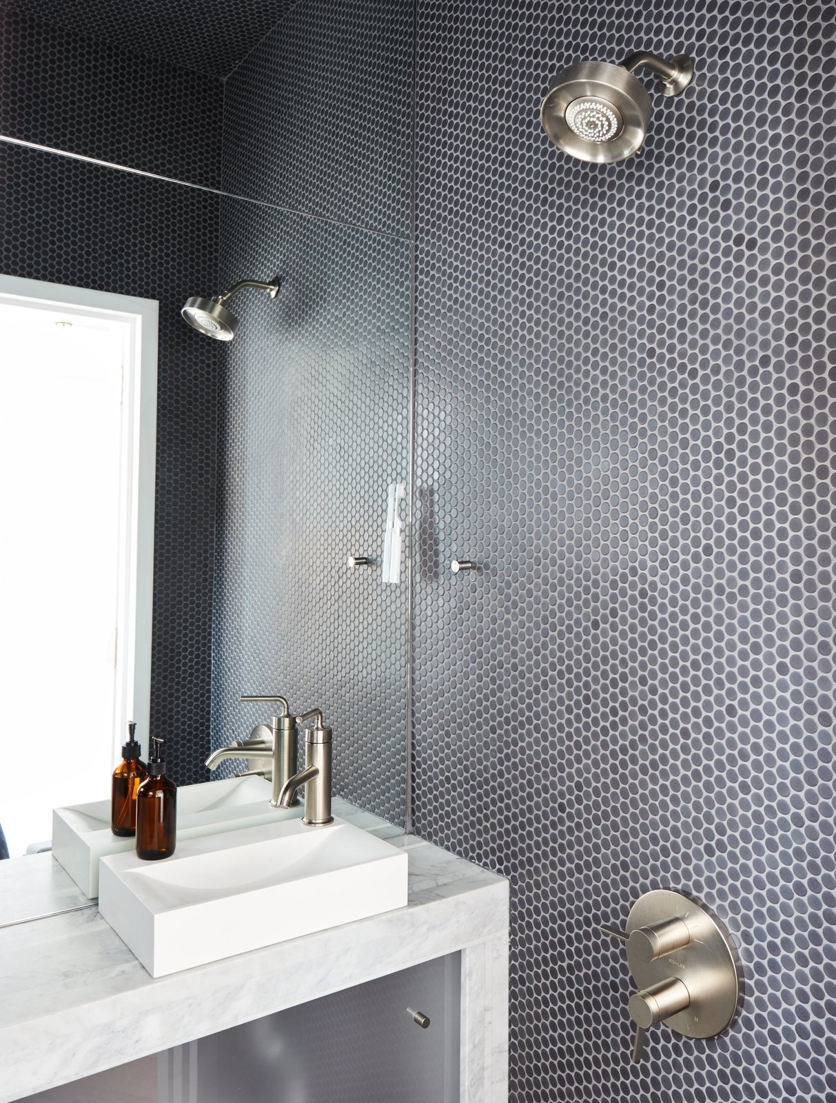 The wet bathroom, clad in Savoy penny tile by Ann Sacks, helped optimize the home's petite footprint. Tagged: Bath Room, Open Shower, Mosaic Tile Wall, Marble Counter, and Vessel Sink.  Photo 11 of 16 in At His 350-Square-Foot Apartment, Small Space Champion Graham Hill Practices What He Preaches