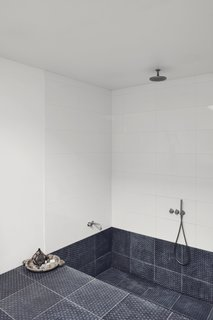 A Recent Trip Leaves Us Dwelling on Denmark - Photo 9 of 14 - The recessed bath and shower makes the space feel like a private spa.