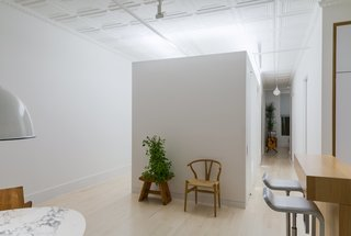 This 60-Square-Foot Structure Divides and Conquers in a Manhattan Renovation - Photo 4 of 8 - The public spaces are separated from the private bedrooms by the new Sheetrock addition.