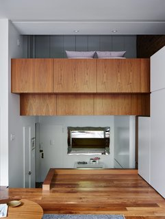 A 16-Foot-Wide Triplex Is Cleverly Reconfigured to Feel Extra Spacious - Photo 1 of 8 - The unusual layout of René Roupinian's Upper West Side home is what initially attracted her to the space, but the three-level plan proved difficult to organize. In his first solo project as STADT Architecture, Christopher Kitterman used a palette of walnut and white to unify the apartment, which he filled with space-saving solutions. Near the entrance, a Goliath table from Resource Furniture can expand to seat up to 10.