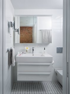 A 16-Foot-Wide Triplex Is Cleverly Reconfigured to Feel Extra Spacious - Photo 7 of 8 - In the bathroom,a little-used tub was replaced by a streamlined shower. Both the Duravit medicine cabinet and the Kimball & Young makeup mirror feature built-in LED lighting.