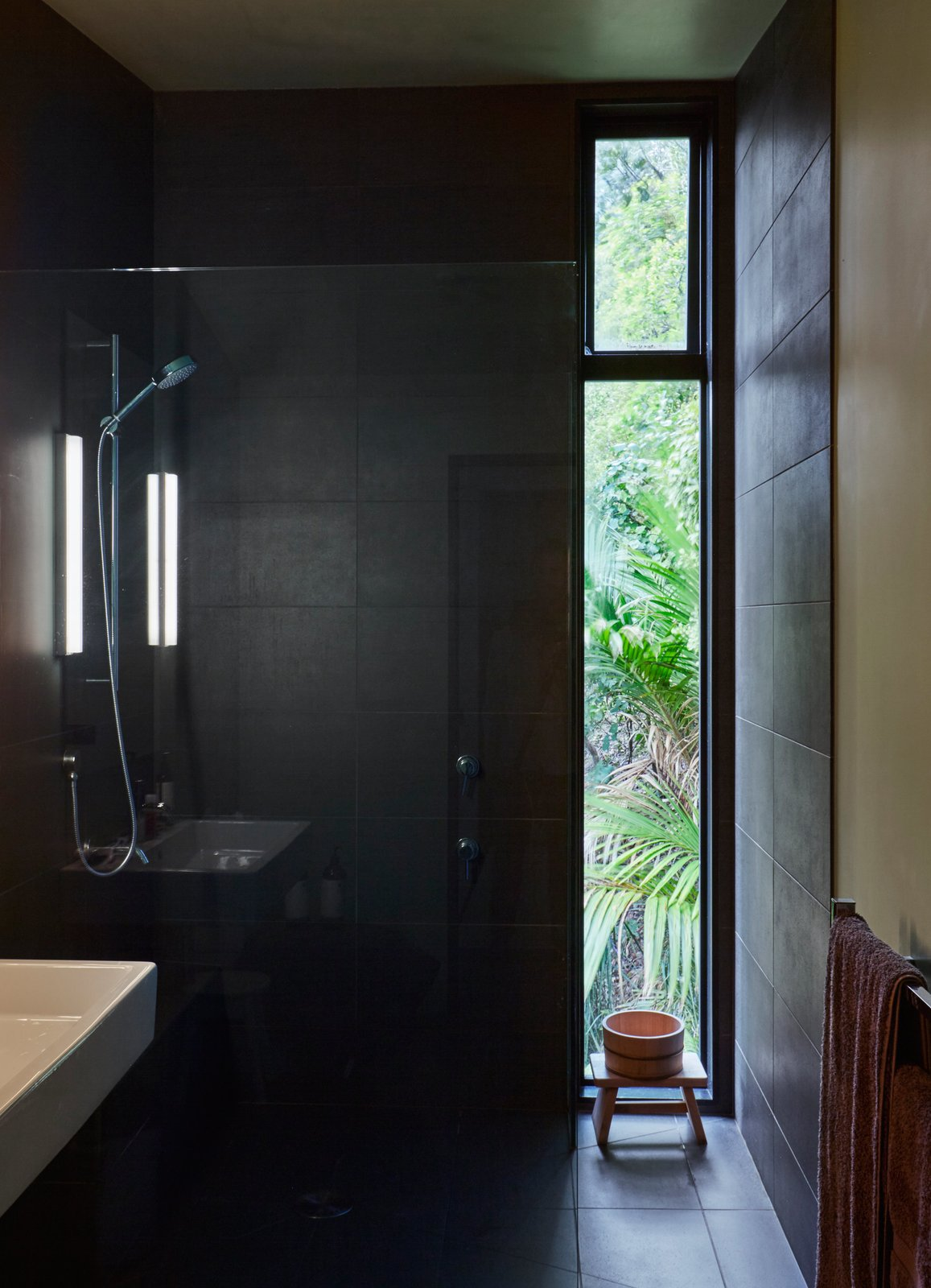The shower is lined in Magma Black tile purchased at the Tile Space in Auckland. Tagged: Bath Room.  Photo 7 of 13 in A Tiny Footprint Isn't So Bad When You Live in a Tower