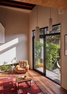 A Tiny Footprint Isn't So Bad When You Live in a Tower - Photo 9 of 12 - In keeping with the spirit of the house, the furniture is humble—most is vintage, like the Anglepoise lamp that sits on a stool near a colorful kilim