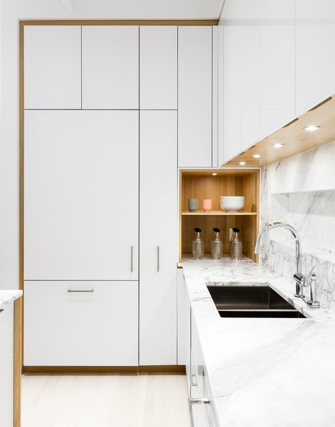 The kitchen was designed in collaboration with Henrybuilt. The laminate cabinets are paired with a marble countertop by SMC Stone.