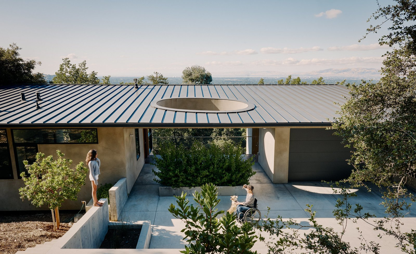 Tagged: Exterior, House, Metal Roof Material, and Flat RoofLine.  Photo 1 of 9 in A Family Guesthouse Made for Accessibility, Aging in Place—and That View