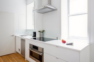 This 390-Square-Foot Renovation Is Compact Yet Comfortable in Greenwich Village - Photo 5 of 9 - The space-saving appliances are all from Bosch's 500 and 800 series.