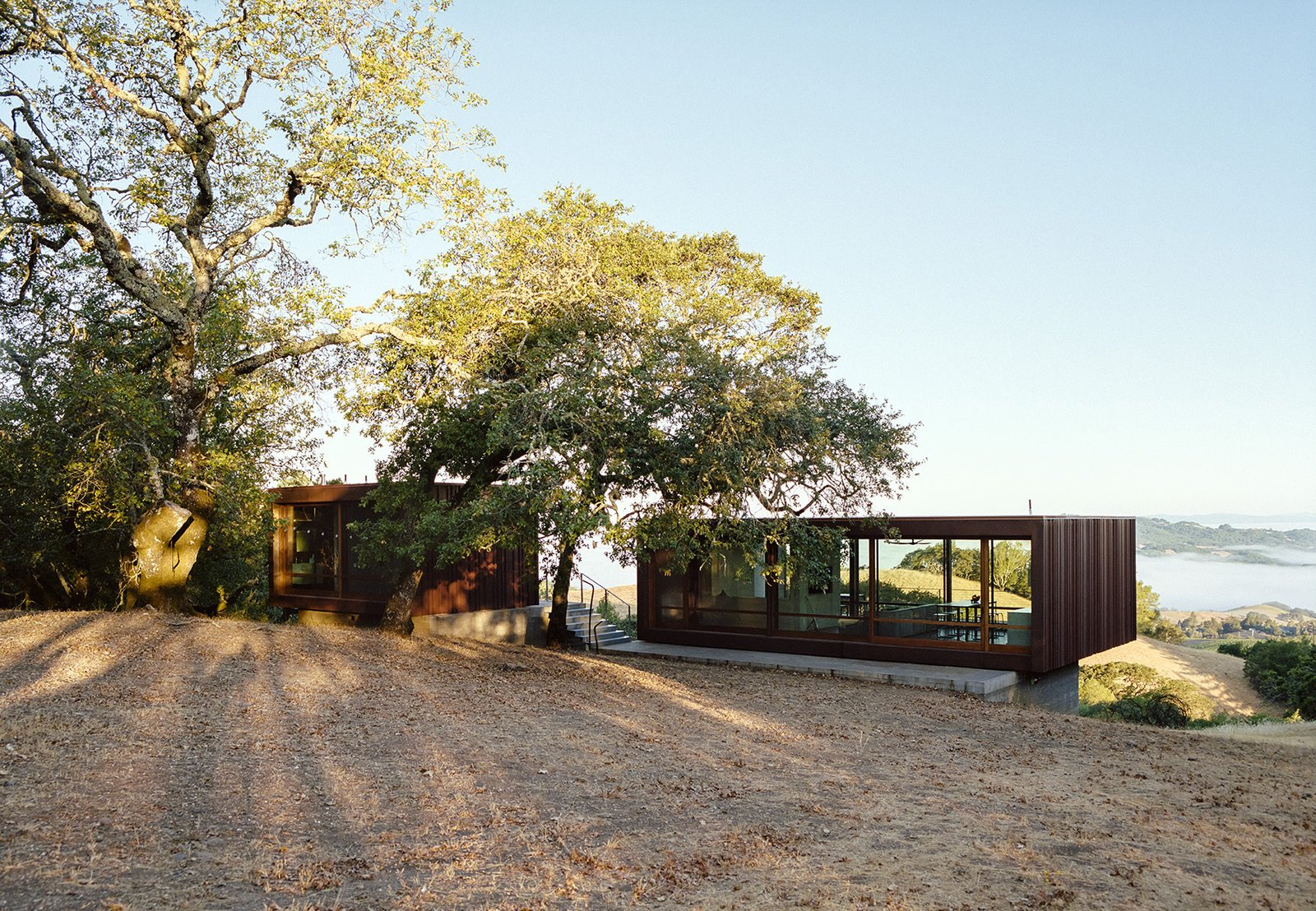 Architects Geoffrey Warner and BJ Siegel collaborated to achieve this prefab home in the Sonoma Mountains. This was originally featured in Dwell 'Steel the Scene.' Tagged: Exterior, Metal Roof Material, House, and Flat RoofLine.  Photo 1 of 5 in Steel the Scene