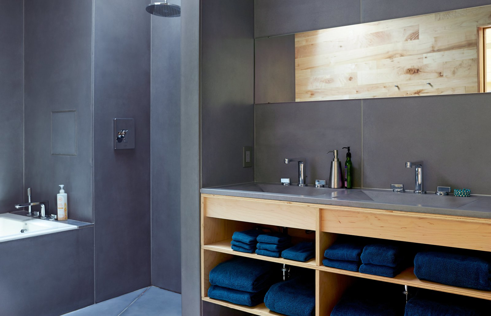 HardLife Products manufactured the bathroom's custom concrete walls, floor slabs, and sink basins, which are paired with faucets by American Standard. Tagged: Bath Room, Open Shower, Concrete Floor, and Concrete Counter.  Photo 6 of 8 in Happy Trails